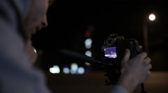 young operator removes the camera at night road in the city center - stock footage
