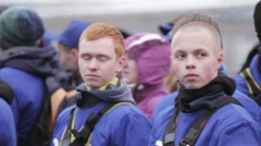 Young boys in blue uniforms watch on stage on emercom teaching. Outdoor Stock Footage