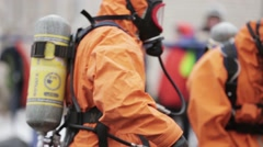 Men in orange protect suits, respiratory masks. Chemical disaster. Toxic Stock Footage