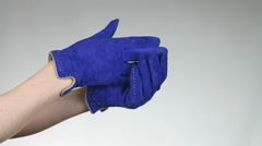 Woman takes both gloves on his hands. Stock Footage