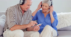 Cute elderly couple listening to music Stock Footage