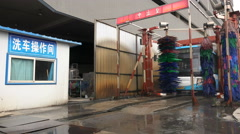 China transport, time lapse of a Chinese public bus driving through a carwash - stock footage