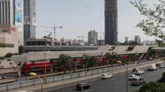 Rail station in Tel-Aviv and road Ayalon highway traffic. Train leaves. Place Stock Footage