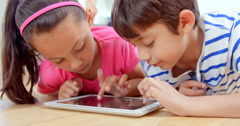 Smiling children playing with tablet Stock Footage