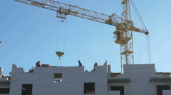 Construction crane, workers work in construction Stock Footage