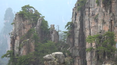 Trees find vegetation on very steep mountains in China Stock Footage