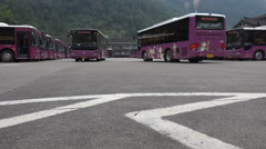 Tour buses take tourists around the Zhangjiajie National Park in China - stock footage