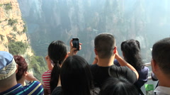 Chinese tourists take pictures of 'avatar' mountains, inside glass elevator Stock Footage