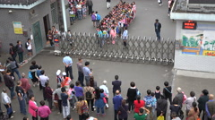 Stock Video Footage of Parents wait for their children to leave the gates of a primary school in China