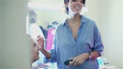 Make up in a dressing room before the photoshoot. - stock footage