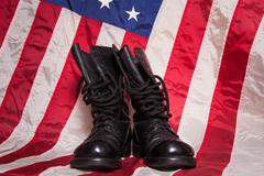 Combat Boots with Flag - stock photo