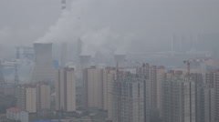 Coal fired power station and empty residential apartments in China Stock Footage