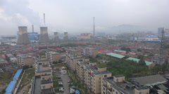 Chinese coal fired power plant in residential neighborhood - stock footage