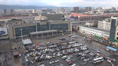 Car park in front of the Hohhot railway station in Inner Mongolia, China Stock Footage