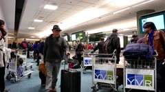 People waiting their luggage inside YVR Airport in Vancouver BC Canada - stock footage