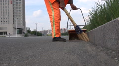 Migrant worker sweeps quiet streets of Ordos, a ' ghost city ' in China Stock Footage