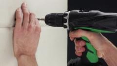 Man attach gypsum board with a electric screwdriver Stock Footage