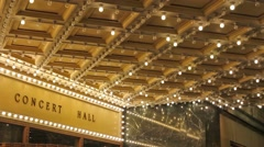 HD of blinking concert hall ceiling lights along a entertainment street 1080p Stock Footage