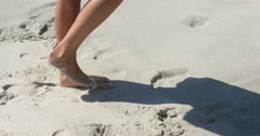 Woman walking on the beach bare footed Arkistovideo