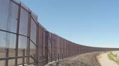 Looking at the US and Mexico Border Fence from Side to Side Stock Footage