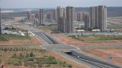 Empty highways, unfinished construction sites, slowdown, China, ghost city Stock Footage