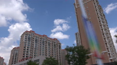 Driving past new empty apartment buildings in Ordos, China - stock footage