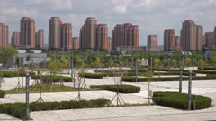 China ghost city Ordos, empty park, property bubble, slowdown economy Stock Footage