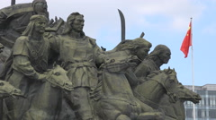 Genghis Khan, Mongolian warrior statues, Chinese flag, Ordos, Kangbashi Stock Footage