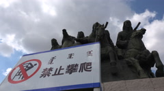 No climbing sign on Genghis Khan statue Ordos China Stock Footage