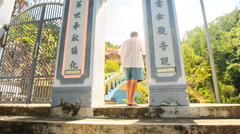 Backside Old Man Comes through Gate Sees Pagoda in Vietnam Stock Footage