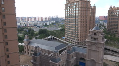 Expensive looking apartment buildings in Chinese ' ghost town ' Ordos - stock footage