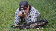 Assassin shooter hunter sniper with rifle and scope 1 of 2  Stock Footage