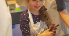 Happy Kid Women Moms Playing Rubber Stamps People Paint in Kindergarten Stock Footage