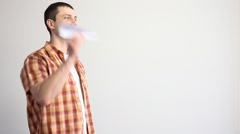 Young man  launching a paper plane Stock Footage