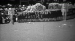 1945: Honor Loyalty Justice WW2 victory flower covered parade float. Stock Footage