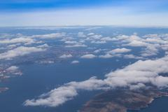 Blue sky with clouds and mountains background, aerial photography Stock Photos