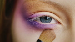 Make-up blue-eyed woman Stock Footage