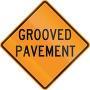 United States MUTCD road sign - Grooved pavement - stock illustration