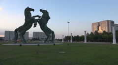 Massive prancing horses statue in downtown Ordos, a ghost city in China - stock footage