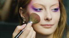 Beautiful woman applied make-up brush Stock Footage