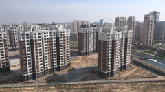 China real estate sector, property market bubble, empty buildings, ghost city Stock Footage