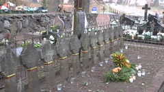 Graves of Lithuanian soldiers in rural cemetery. Zoom out. 4K Stock Footage