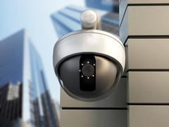 Dome camera hanging on the wall of office building Stock Illustration