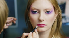 Stock Video Footage of Models to apply makeup in the beauty salon