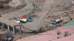 Rusty water trucks, empty sports stadium, deserted venue, ghost city China Stock Footage