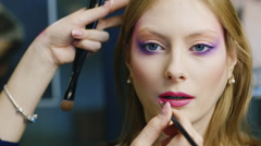 Beautiful young woman apply lipstick on her lips Stock Footage