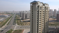 Empty buildings, quiet roads, ghost town, real estate bubble, Ordos, China - stock footage