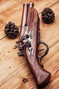 Old musket - stock photo