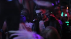 Sexy man in collar, jaket and muzzle with spikes dance in crowded nightclub Stock Footage