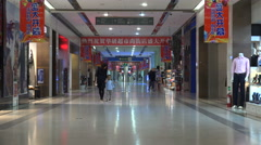 Mother and child walk through empty shopping mall in Ordos China Stock Footage